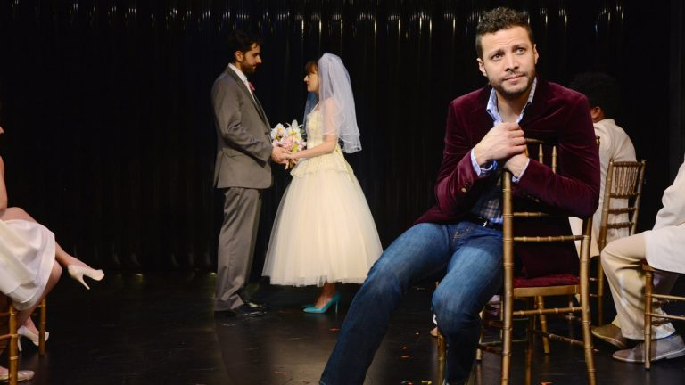 In the foreground, Justin Guarini, with John Caliendo and Kate Wetherhead in the background in Bucks County Playhouse's production of 'Company.' (Photo courtesy of Mandee Kuenzle)