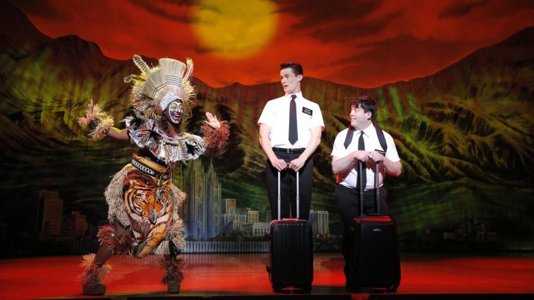 Kelechi Ezie (left) greets KJ Hippensteel and Christopher John O'Neill, as two would-be Mormon proselytisers, in 'The Book of Mormon' at the Forrest Theatre