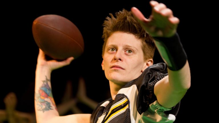 Jess Barbagallo as the quarterback in 'In the Pony Palace/FOOTBALL' from Half Straddle, and part of the Philly Fringe Festival. (Photo courtesy of Shameel Arafin)