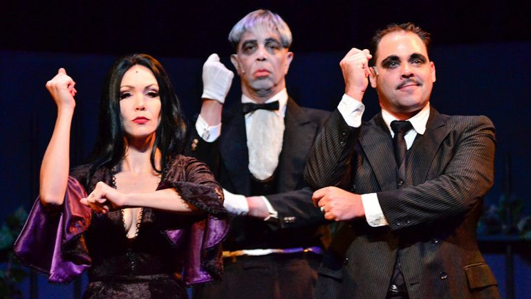 Jennie Eisenhower as Morticia, Bill Vargus as the butler, and Jeffrey Coon as Gomez in Media Theatre's production of the musical