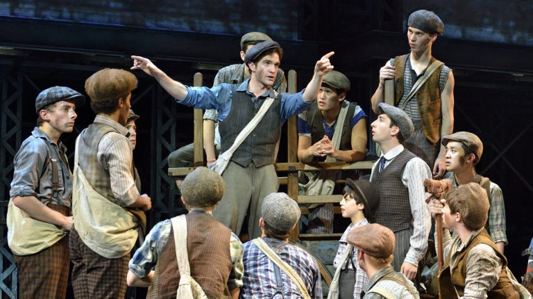 Dan DeLuca gives instructions to the striking newsboys in 'Newsies,' beginning its national tour at the Academy of Music. (Photo courtesy of Deen van Meer)
