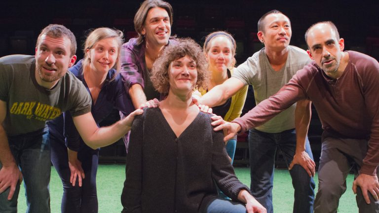 The members of Team Sunshine Performance Corporation's 'The Sincerity Project' at FringeArts: In the center is Melissa Krodman. The other cast members, who have her back, from left: Ben Camp, Jenna Horton, Mark McCloughan, Rachel Camp, Makoto Hirano and Aram Aghazarian.