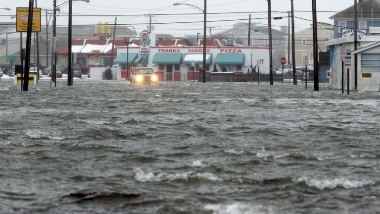 Water floods New Jersey Avenue in North Wildwood