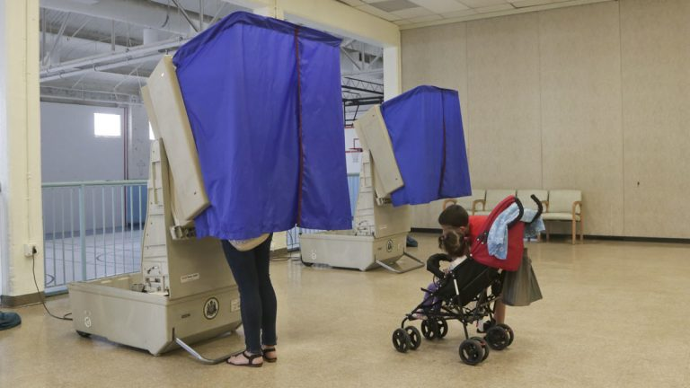 A woman votes at the Salvation Army in Philadelphia's 7th Council District. (Kevin Cook/for WHYY)