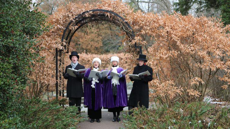Carolers at Morris Arboretum. (Natavan Werbock/for NewsWorks)