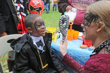 A face-painting artist was on sight helping trick-or-treaters enhance their costumes (Natavan Werbock/for NewsWorks)