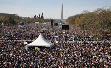 Thousands participate in the Rally to Restore Sanity and/or Fear on the National Mall in Washington, D.C., in 2010 during an event hosted by Stephen Colbert and Jon Stewart. (AP file photo)