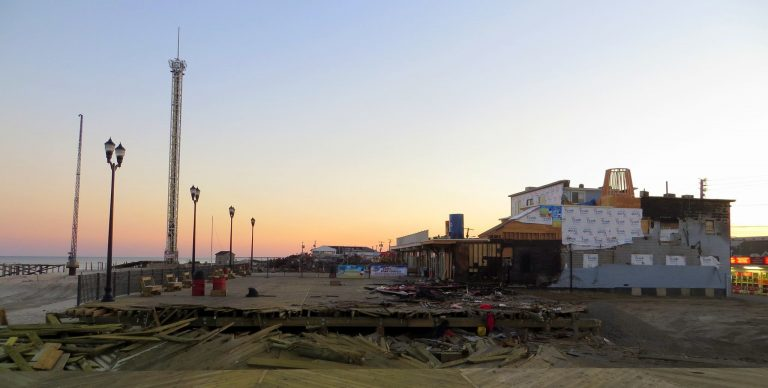 The Sawmill Cafe, the southernmost building on the Seaside boardwalk, is now clearly visible from the trench that was dug at Lincoln Avenue to stop the fire from advancing northward. The numerous buildings that once blocked a clear view to the south have been demolished. JSHN contributor Kevin Michelson snapped this image at sunset on October 21, 2013.