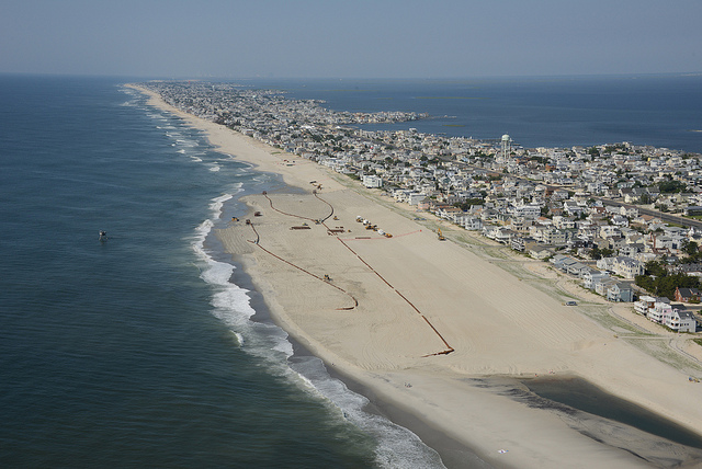 The U.S. Army Corps of Engineers Philadelphia District pumps sand onto Brant Beach, NJ in June 2013. The work is part of an effort to restore the Coastal Storm Risk Management project from damages associated with Hurricane Sandy. (Image: U.S. Army Corps of Engineers)