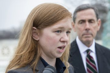 Abigail Fisher, who challenged the use of race in college admissions, joined by lawyer Edward Blum, right, speaks to reporters outside the Supreme Court in Washington on Dec. 9, 2015.  (AP Photo/J. Scott Applewhite)