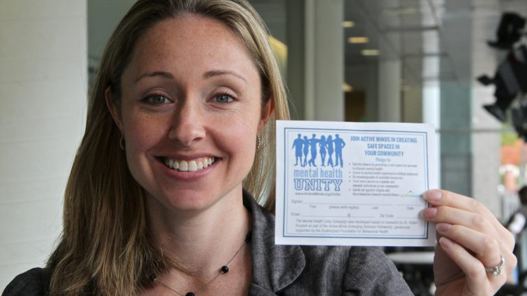 Alison Malmon founder of Active Minds displays one of the pledge forms. (Emma Lee/WHYY)