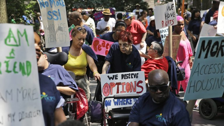 People marching with United Cerebral Palsy prepare to participate in the inaugural Disability Pride Parade in New York, Sunday, July 12, 2015. The parade grand marshal was former U.S. Sen. Tom Harkin, the Iowa Democrat who 25 years ago sponsored the Americans With Disabilities Act. (AP Photo/Seth Wenig)
