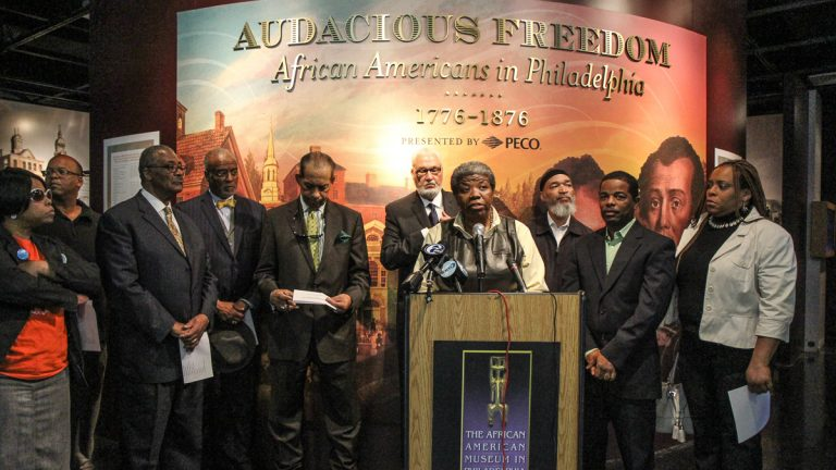 Asia Coney, president of the Resident Advisory Board, and other participants in the Philadelphia Black Political Summit Coalition announce their recommendations to city government at a press conference Wednesday. (Kimberly Paynter/WHYY)