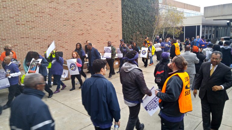 Airport workers take to the picket lines at Philadelphia International Airport. (Tom MacDonald/WHYY)