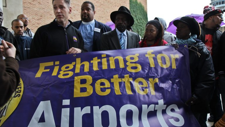 Airport workers, union members and officials protest working conditions at an airport terminal in this NewsWorks file photo (Kimberly Paynter/WHYY)