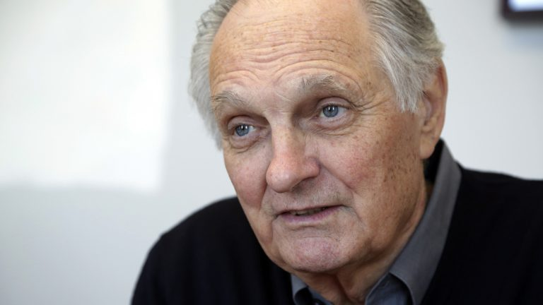 Film and television star Alan Alda is shown speaking during an interview at Stony Brook University, on New York's Long Island, in 2013. (AP Photo/Richard Drew, file)