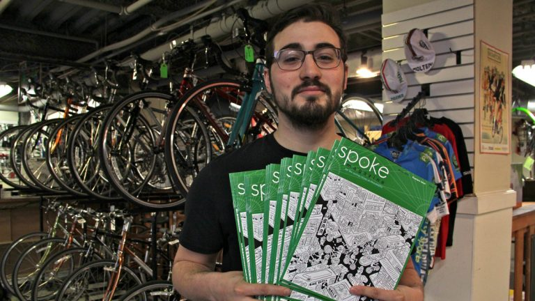 Alex Vuocolo, editor of the new urban cycling magazine Spoke, drops off some copies at Trophy Bikes on Second Street. (Emma Lee/WHYY)