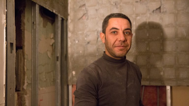 Japour Ibrahim, a Syrian refugee, said he came to Allentown with his family in April 2015. There he found work helping to restore the Americus Hotel in Center City, Allentown. (Lindsay Lazarski/WHYY)
