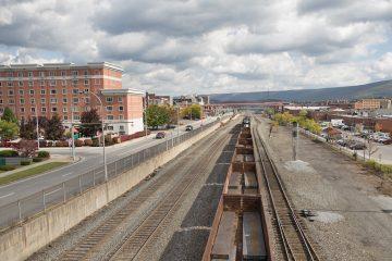 A cargo train passes through downtown Altoona
