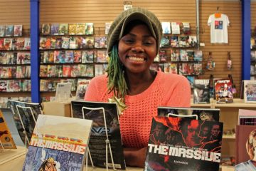 Ariell Johnson's new venture, Amalgam Comics and Coffeehouse in Kensington, has her busy keeping the books, stocking the shelves and baking cookies. (Emma Lee/WHYY)