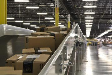 Packages move down a conveyer belt at Amazon's Fulfillment center in New Castle, Del. (Kimberly Paynter/WHYY)