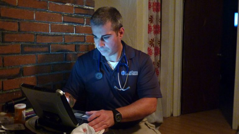 Paramedic Joe Sequeira makes house calls in an attempt to keep patients out of the emergency room. (Todd Bookman/WHYY)