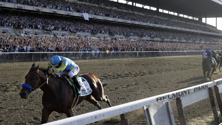 American Pharoah and jockey Victor Espinoza cross the finish line to win the 147th running of the Belmont Stakes horse race at Belmont Park, Saturday, June 6, 2015, in Elmont, N.Y. American Pharoah is the first horse to win the Triple Crown since 1978. (AP Photo/Julio Cortez)