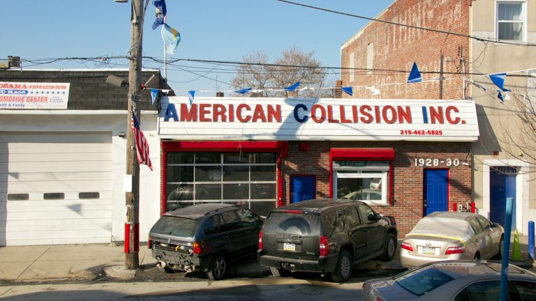 A spokesman for the city said that they will stop sending vehicles to the American Collision & Automotive shop for the remainder of its current contract which is due to expire in late January. (Nathaniel Hamilton/for NewsWorks)