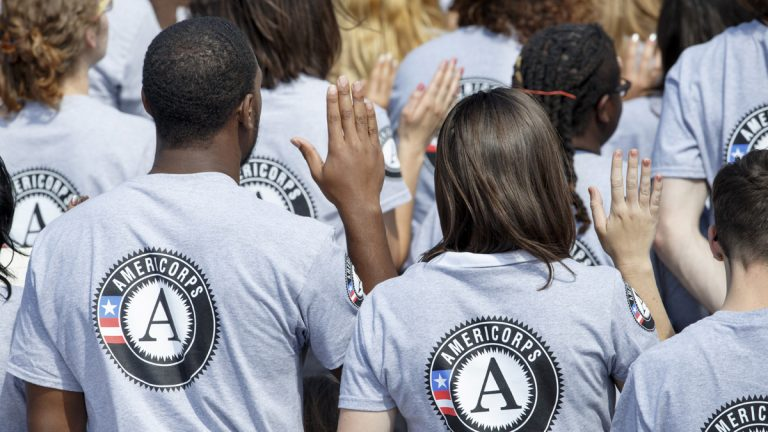 Hundreds of new volunteers are sworn in for duty at a ceremony marking the 20th anniversary of the AmeriCorps national service program in 2014. (AP Photo/J. Scott Applewhite)