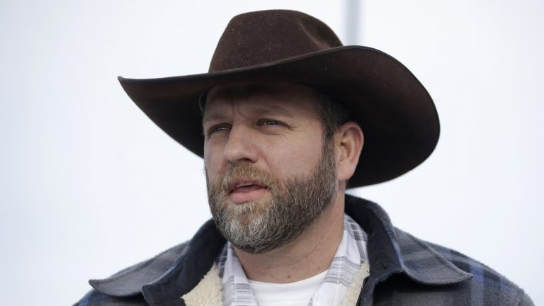 Ammon Bundy, one of the sons of Nevada rancher Cliven Bundy, speaks with reporters during a news conference at Malheur National Wildlife Refuge headquarters Monday, Jan. 4, 2016, near Burns, Ore. (AP Photo/Rick Bowmer)