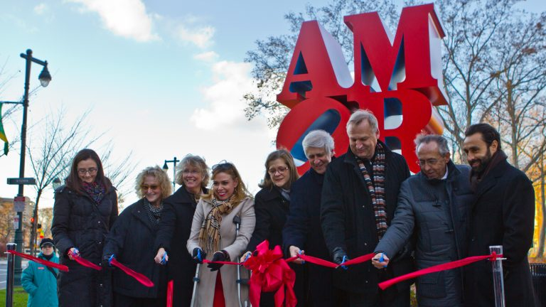Robert Indiana's AMOR statue is dedicated at Sister Cities Park on the Parkway Friday afternoon. (Kimberly Paynter/WHYY)
