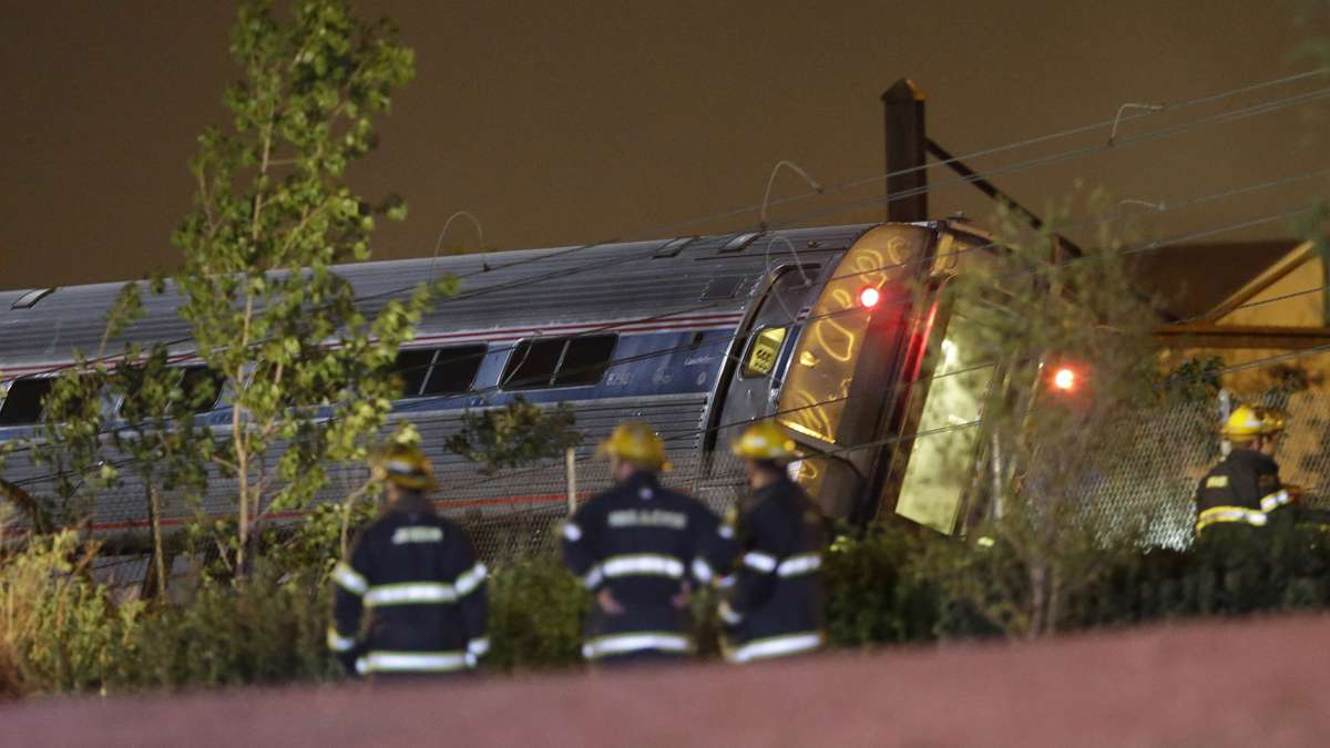 Emergency personnel work the scene of a train wreck, Tuesday, May 12, 2015, in Philadelphia. An Amtrak train headed to New York City derailed and crashed in Philadelphia. (Matt Slocum/AP Photo)