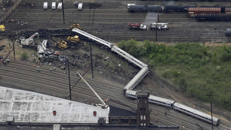 Emergency personnel work at the scene of a deadly train derailment, Wednesday, May 13, 2015, in Philadelphia. The Amtrak train, headed to New York City, derailed and crashed in Philadelphia on Tuesday night, killing at least six people and injuring dozens of others. (Patrick Semansky/AP Photo)
