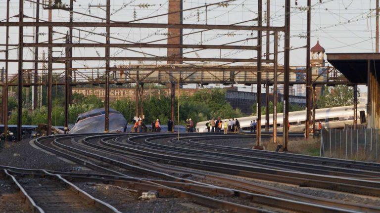 Investigators return to crash scene Thursday morning in North Philadelphia. (Brad Larrison/for NewsWorks)