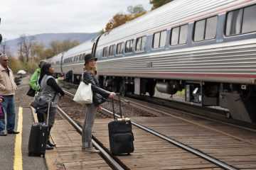 Joanne Landis (with black hat) gets ready to board an Amtrak train enroute to New York City at the Lewistown Station in Pennsylvania.  There is only one round-trip passenger train that runs from Harrisburg to Pittsburgh