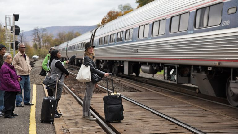 No fast track to expanding passenger rail in western pennsylvania joanne landis with black hat gets ready to board an amtrak train enroute to sciox Images
