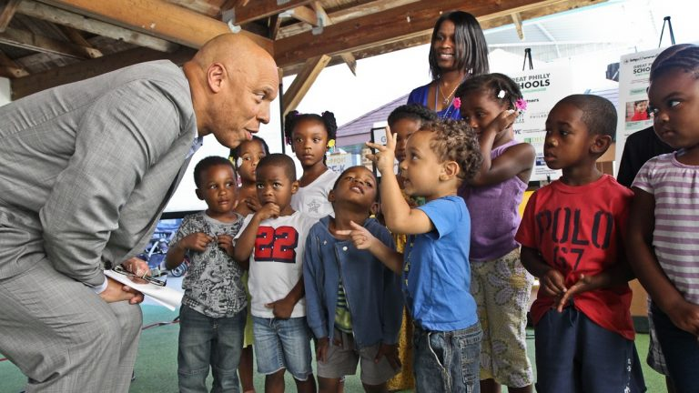 Superintendent William Hite is joined by Montgomery Early Learning Center's students in West Philadelphia at an announcement of a new website that will help parents find high quality Pre-K programs in Philadelphia. (Kimberly Paynter/WHYY)