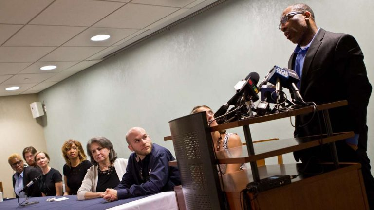 Anthony Wright, 45, was acquitted of the 1993 murder of Louise Talley, 77, and released from prison Tuesday evening. Wright speaks to press Wednesday with the jury who rendered the not-guilty verdict by his side. (Kimberly Paynter/WHYY)