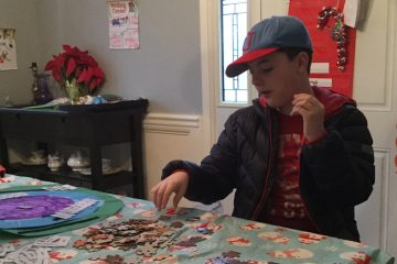 Anthony Burke takes a puzzle break from his applied behavioral analysis - or ABA therapy - in his dining room. (Kyrie Greenberg/ for NewsWorks)