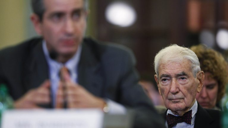Ralph Roberts, founder of Comcast Corporation, right, watches as his son Comcast Corporation Chairman and CEO Brian Roberts testifies on Capitol Hill in Washington in 2010 before a Senate Commerce Committee hearing on consumers, competition, and the proposed Comcast-NBC merger. The elder Roberts died Thursday in Philadelphia at 95. (AP photo/file)