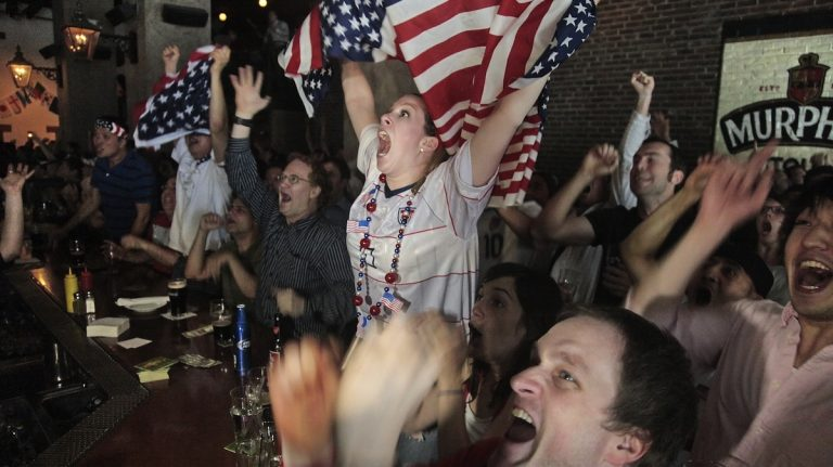 United States soccer fans react after the U.S. scored their second goal against Slovenia as they watch a live broadcast of the World Cup game at Stout's bar in New York on Friday, June 18, 2010. (Photo/Bebeto Matthews)