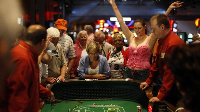 In 2010, people play recently legalized table games on a test day at the Sands Casino Resort Bethlehem in Bethlehem, Pa. Owners of the casino object to proposals to offer online gaming in Pennsylvania. (Matt Rourke/AP Photo)