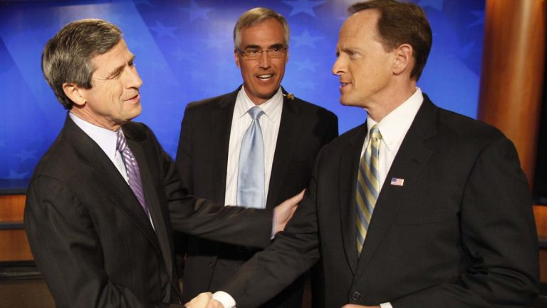 Pennsylvania Senate candidates Democratic Rep. Joe Sestak, D-Pa., left, and Republican Pat Toomey, shake hands in front of moderator David Johnson before a debate broadcast live from a television studio in Pittsburgh in October 2010. (AP file photo)