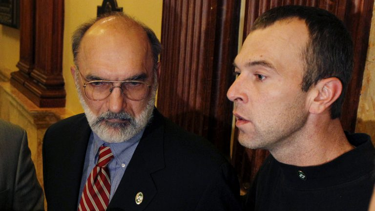Ken Wolski of the Coalition for Medical Marijuana New Jersey listens as Charles Kwiatkowski, right, of Hazlet, N.J., who suffers from multiple sclerosis, describes his need for medical marijuana in 2010. (Mel Evans/AP Photo)