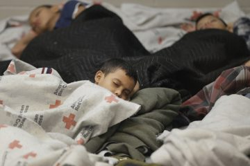 Last month, young detainees sleep in a holding cell at a U.S. Customs and Border Protection processing facility in Brownsville, Texas. Immigration courts backlogged by years of staffing shortages and tougher enforcement face an even more daunting challenge since tens of thousands of Central Americans began arriving on the U.S. border fleeing violence back home. (AP file photo/Eric Gay, pool)