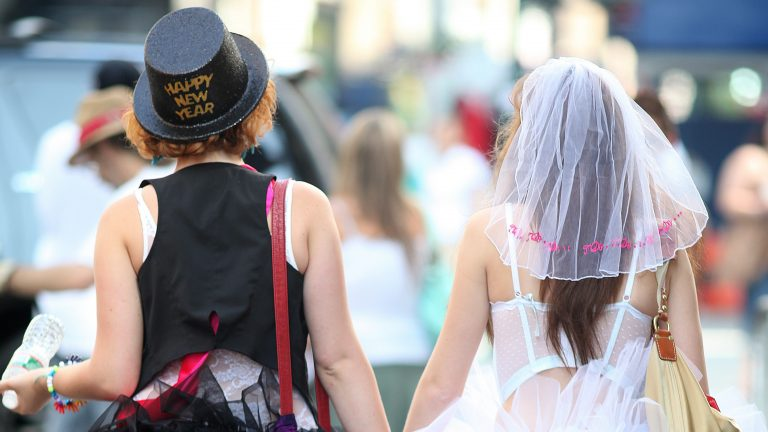 Two women dressed as brides hold hands before the start of the annual Gay Pride parade in New York. (AP Photo/Chelsea Matiash, file)