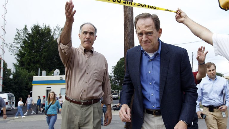 U.S. Sens. Bob Casey, left, and Pat Toomey say they have worked together on a number of issues, including this trip to inspect flooding damage in 2011. (AP file photo)
