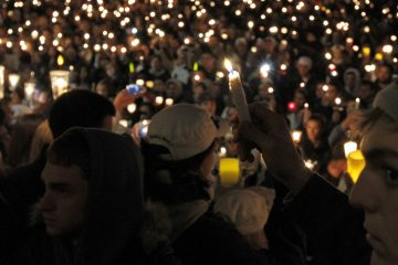 People hold a candlelight vigil to support sex abuse victims in front of the Old Main building on the Penn State Campus in November 2011 in State College, Pa. The state  Senate will take up a measure to reduce the size of Penn State's Board of Trustees, thereby responding to criticisms of how the university handled the Jerry Sandusky child sex abuse case.  (AP Photo/Alex Brandon)