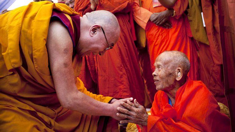 Tibetan spiritual leader the Dalai Lama, left, greets a Thai Buddhist leader at the Gandhi Memorial in New Delhi in 2011. The spiritual leader will visit Princeton University Tuesday. (AP file photo)
