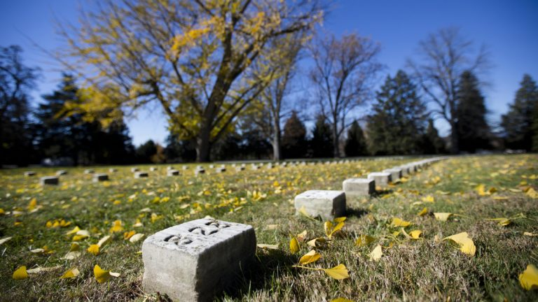 Grave markers line Soldiers' National Cemetery in Gettysburg, Pa. A skull, presumably that of a Civil War soldier, had been set for auction. After protests, the remains will be authenticated then buried in the cemetery. (AP file photo/Matt Rourke)